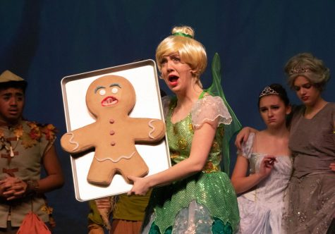 Senior Cait Smith, while playing Tinkerbell, holds up Gingy, a character in Shrek. She played another character in the production, that being a happy villager.
