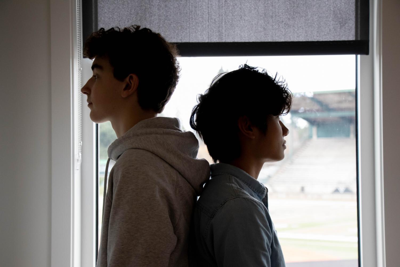 Sophomore Owen Kosmala and Noah Vu both have similar haircuts, but Vu has a perm and Kosmala's hair is naturally curly.