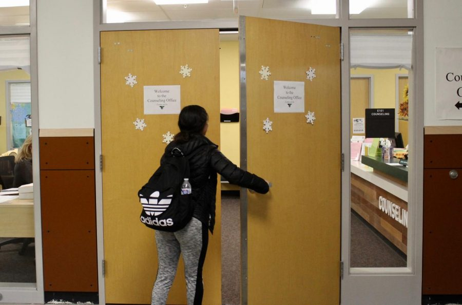 A+student+is+pictured+entering+the+counseling+office.+The+doors+must+open+outward+due+to+safety+regulations.