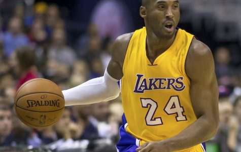 A picture of former LA Lakers' player Kobe Bryant playing against the Washington Wizards on December 3rd, 2014. Bryant's basketball skills were an inspiration to many on and off the court.