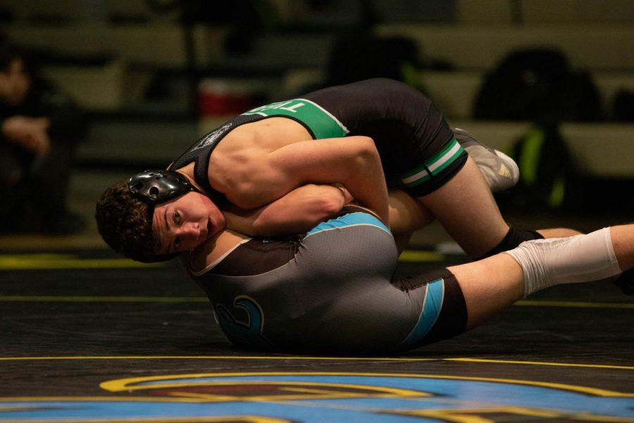 Freshman Cade McCallister finishes his match against Lakeridge on Jan 16.