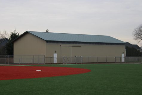 The new softball field and hitting barn, being finished now make a prominent impact on the upcoming softball season.