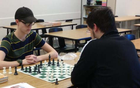 Juniors Kyle Hering (left) and Tristan Parkinson (right) play against each other at the Chess Club's tournament on Feb. 19.
