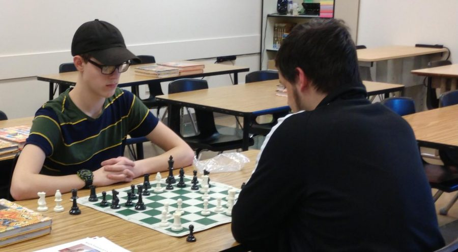 Juniors Kyle Hering (left) and Tristan Parkinson (right) play against each other at the Chess Clubs tournament on Feb. 19. The club is very relaxing, junior Arslon Krebs said.