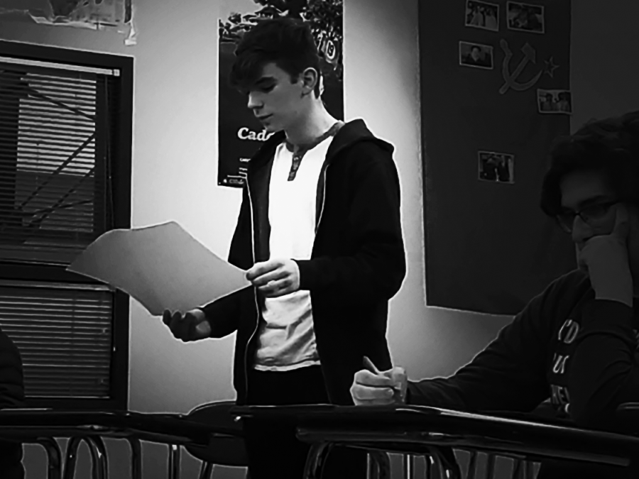 Freshman Gavin McLeod practices for an upcoming speech and debate tournament. The team has had five coaches in the past five years.
