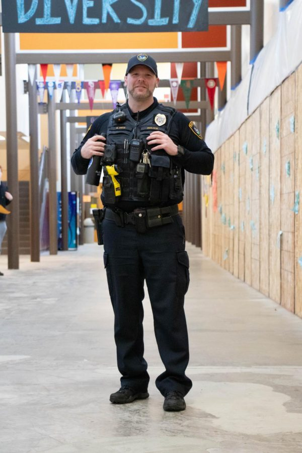 Student Resource Officer Brian Imus patrols hallways at Tigard. He explains the Tigard Police Department's role in the school's safety.