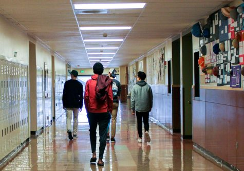 Although TTSD cancels school on March 13, students could come in and pick up books and computers. A group of junior boys wandered through the empty science hall.