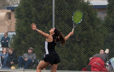 Tigard alumna Nicole Mazzeo plays at the school's old tennis court. This year, the girls tennis team faces freezing weather as the season begins.