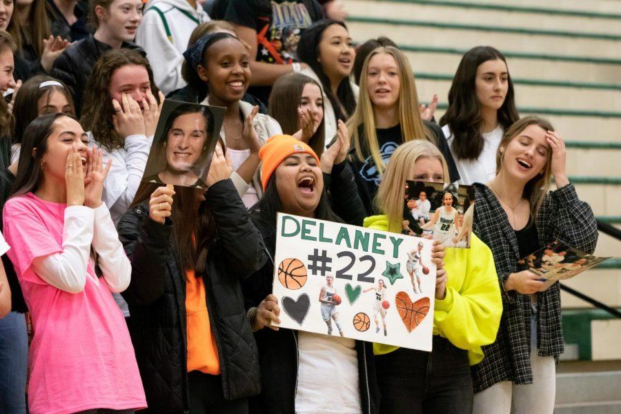 Seniors Kristiana Saldana, Juliana Padia, Kalani Korok, Logan Harris-Kennedy, and Grace Nelson cheer on Senior Delaney Leavitt on the girls basketball Senior Night.