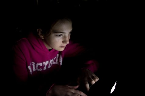 Without a typical school year schedule, teens do work into the wee hours of the morning. Hannah Currier worked on a slam poem for her language arts class, the room illuminated by the light of the computer screen.