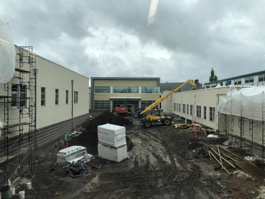 Although+the+courtyard+is+still+a+mud+pit%2C+the+building+is+coming+along+around+it.+The+business+wing%2C+commons+and+athletic+wing+will+be+ready+for+students+in+the+fall.