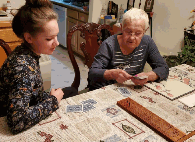 Deja Fitzwater and her grandmother play cribbage. Fitzwater has been living with her grandparents since distance learning began.
