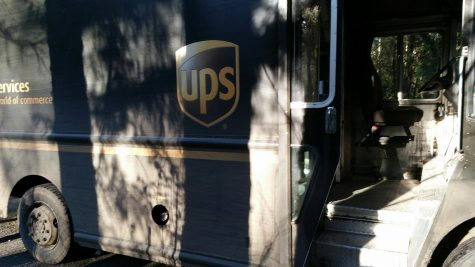 UPS drivers like Robert Ervin work extra hours to deliver packages. More people have turned to ordering online rather than going into stores during the COVID-19 pandemic.