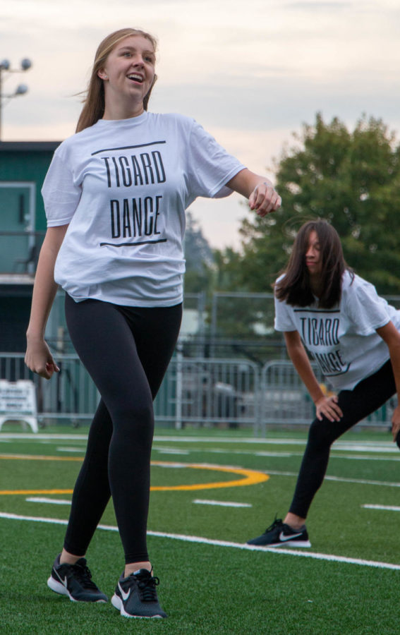 Junior Kayla Kumm dances during the Tigerettes performance at the assembly on Friday, September 17. She thought it was nice to get back in font of a real audience.