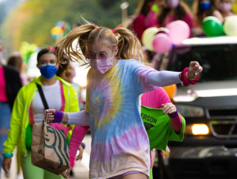 Junior Alyssa Thoren dances her way down Durham Road. On Oct. 8 some homecoming events continued as usual like the parade and football game. Powderpuff and the dance were postponed.