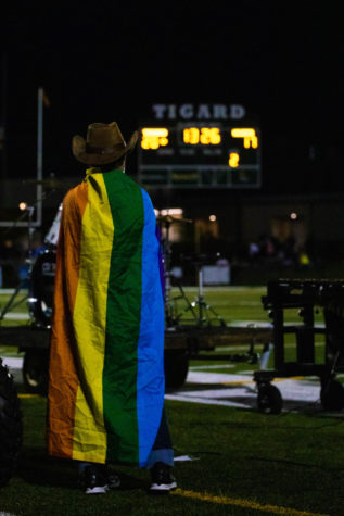 A band member shows support for the LGBTQ+ community during the halftime show at the game against Newberg on Sept. 24. The school supported equity groups during club rush on Oct. 13.