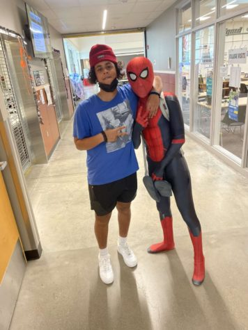 Sophomore Maalik Barkhadle has his picture taken with Spiderman during school on Oct. 27. Some students dressed up for Halloween on the last day of classes before the holiday. Spidermans real identity remained a secret.